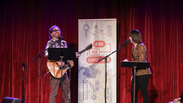 <em>Ask Me Another</em>'s house musician Jonathan Coulton leads a music parody game alongside Ophira Eisenberg at the Bell House in Brooklyn, New York.