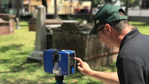 Davide Tanasi taking 3D digital images at Tolomato Cemetery in St. Augustine.