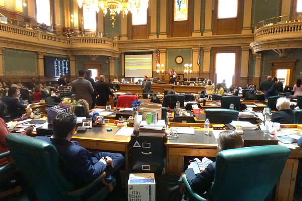 Lawmakers in the House of Representatives listen to Speaker KC Becker on the last day of Colorado's legislative session.