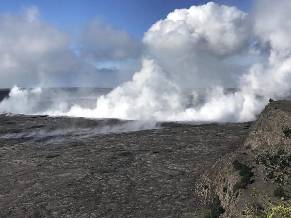 This photo shows an early-morning view of Halema'uma'u Crater and the Kilauea Caldera June 5, 2018. The volcano is no longer erupting but is still active.