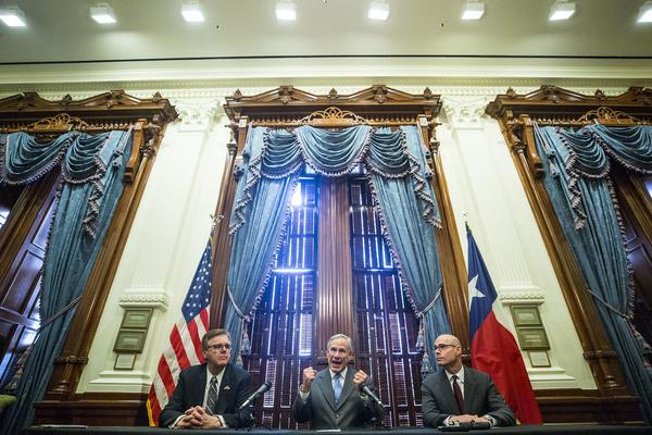 Lt. Gov. Dan Patrick, Gov. Greg Abbott and House Speaker Dennis Bonnen discuss property tax legislation at the Capitol on Friday.