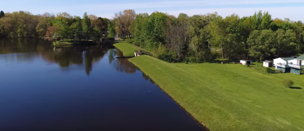 Drone footage of Brimfield Lake from May 2017 shows the dam and homes near the lake.
