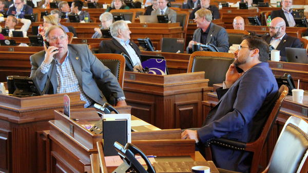 Republican Majority Leader Rep. Dan Hawkins (left) and Kansas House Speaker Ron Ryckman worked the phones to secure enough votes to end a standoff over Medicaid expansion and pass the budget to end the legislative session.
