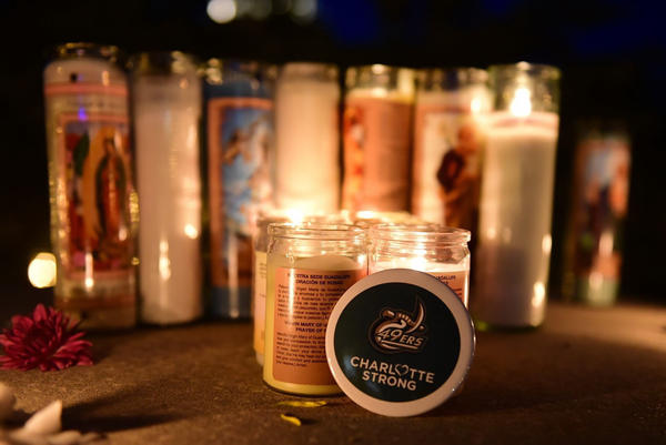 Students at the University of North Carolina at Charlotte were finishing up their last day of classes when the shooting happened. The day after, students and people from the community held a vigil for the victims.
