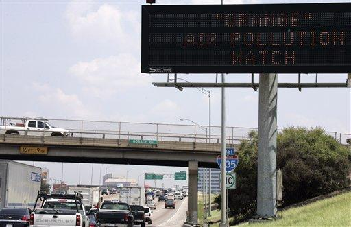 A sign posting an alert for bad air quality is shown along Interstate Highway 635 in Dallas, Tuesday, Sept. 8, 2009.