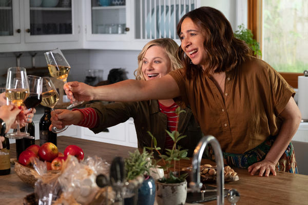 Abby (Amy Poehler) and Naomi (Maya Rudolph) share a toast in<em> Wine Country. </em>