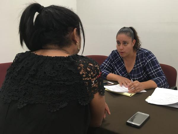"Attorney Linda Rivas (right) with the nonprofit Las Americas of El Paso meets with a transgender migrant woman sent back to Mexico as part of the Trump administration's ""Remain in Mexico"" policy."
