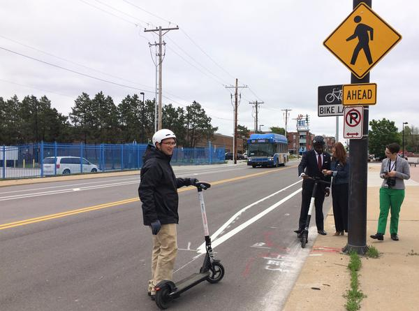 Eric Vaughan from BikeWalkKC tries out RideKC's new electric scooter at 18th and Lidia, where new bike and scooter lanes have recently been installed.