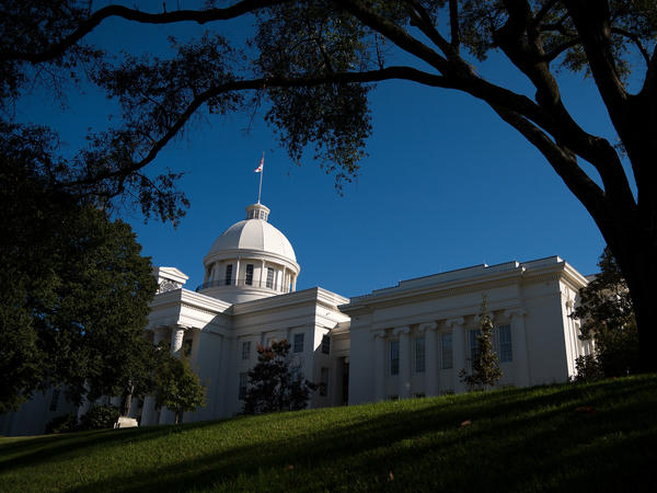 The Alabama Senate postponed a vote on a highly restrictive abortion bill after controversy over an amendment that would provide an exception in cases of rape or incest.
