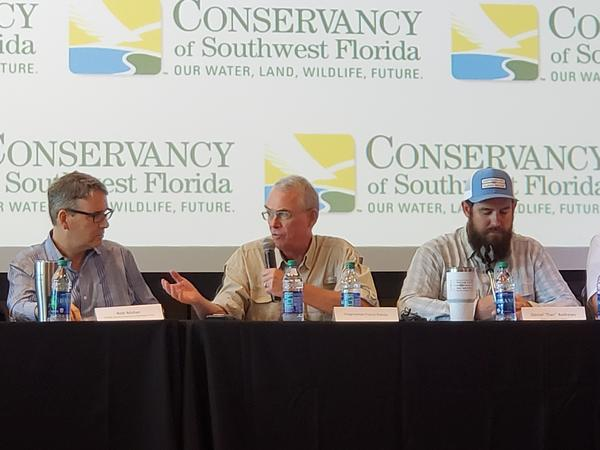 (from left) Conservancy of Southwest Florida President/CEO Rob Moher, U.S. Rep. Francis Rooney, R-Naples, Daniel Andrews with Captains for Clean Water