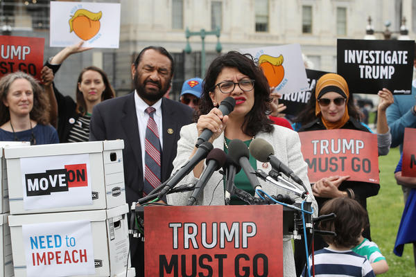 Rep. Rashida Tlaib, D-Mich., speaks to activists gathered Thursday in Washington, D.C., to deliver more than 10 million petition signatures to Congress urging the House to start impeachment proceedings against President Trump.