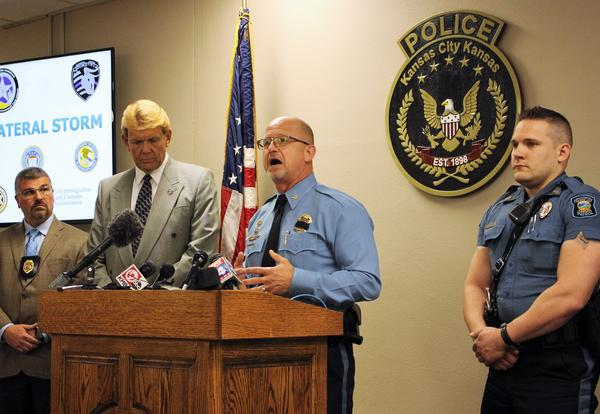 At a press conference Monday, U.S. Marshal Ron Miller, left, and Kansas City, Kansas Police Chief Terry Ziegler, center, shared the results of a special operation targeting drug and 'gang' activity in KCK.