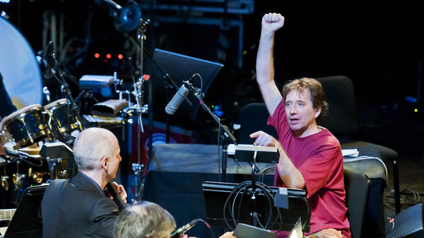 "John Zorn, in red, conducts music from ""Book of Angels"" with the Bar Kokhba Sextet (featuring Marc Ribot on guitar, Mark Feldman on violin, Erik Friedlander on cello and Cyro Baptista on percussion) during his ""Masada Marathon"" at Lincoln Center in New York on March 30, 2011."
