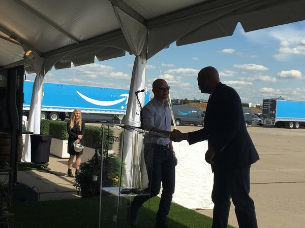 Jeff Bezos (left) suprised guests at the Amazon groundbreaking Tuesday.