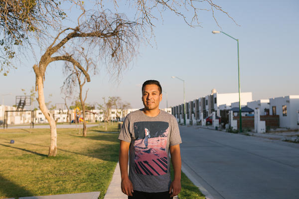 Gilberto Olivas-Bejarano walks through his neighborhood in León, in the Mexican state of Guanajuato. Olivas-Bejarano was deported to Mexico after residing in the U.S. for 26 years.