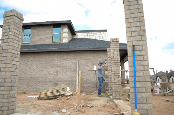 A construction worker works on a home in Odessa, Texas. The Midland-Odessa area is one of the fastest- growing areas in the country in terms of population, and has attracted a number of Millennial homebuyers.