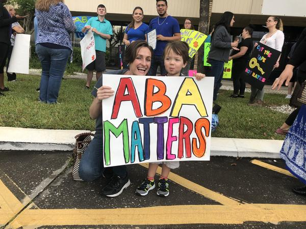 Adrianne Smith, behavior analyst and co-owner of Creative Behavior Solutions in Largo, attended AHCA's Tampa public meeting April 5 with her client, 3-year-old Dominick.