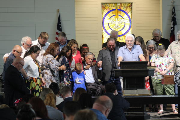 Survivors joined Pastor Paul Buford on stage. Buford is pastor at the nearby River Oaks Church, which served as a staging location for family members to get information about loved ones after the 2017 shooting.