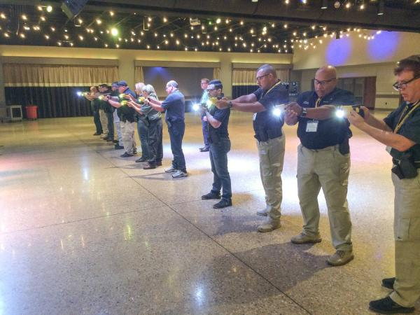 Taser trainers run practice drills with the new Taser 7 in the ballroom of a conference center outside Fort Worth in October.