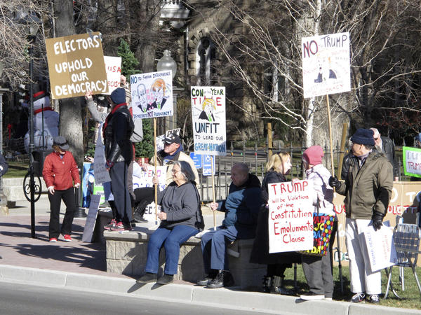 Protesters demonstrate against then President-elect Donald Trump outside the State Capitol building in Carson City, Nev., in December 2016 while Nevada's six Democratic presidential electors inside cast their official Electoral College ballots for Hillary Clinton.