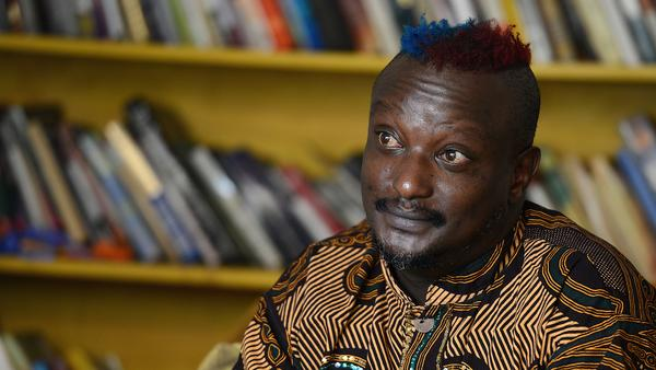 Kenyan author Binyavanga Wainaina, seen here during a January 2014 interview in Nairobi, has died at the age of 48. A founder of the Nairobi-based literary network <em>Kwani?</em>, Wainaina had come out as gay in a country where homosexuality was illegal.