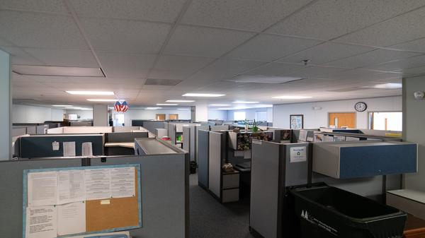 Cubicles lay in neat rows at the call center for Missouri's Adult Abuse and Neglect Hotline. The hotline only answered half of calls placed to it last year.