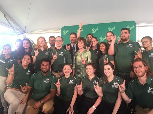 USF System President Judy Genshaft and her husband, Steven Greenbaum, are surrounded by students from the USF Honors College. The school will take Genshaft's name thanks to a $20 million gift from the couple.