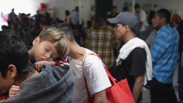 Immigrant asylum-seekers wait for aid at the Catholic Charities Humanitarian Respite Center after being released by U.S. Customs and Border Protection in McAllen, Texas. Migrants told NPR conditions in the CBP holding cells were unhealthy.