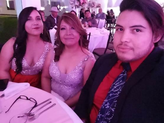 Oscar Cantua (far right) with his sister, Karina Rivera (far left), and mother, Lourdes Contreras (center), at a December 2018 wedding in Mexico.