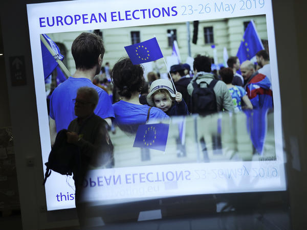 A man walks past a board announcing elections at the European Parliament in Brussels on Wednesday. Some 400 million Europeans from 28 countries are eligible to vote.