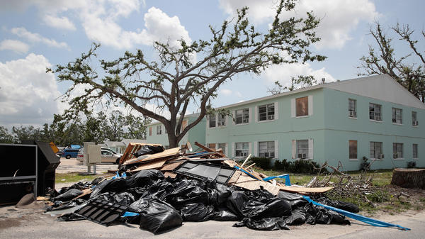 Debris is piled on May 10 outside an apartment complex that was damaged by Hurricane Michael in Panama City, Fla. Rep. Chip Roy objected to a procedural vote on a bipartisan $19.1 billion disaster aid bill, forcing Congress to wait until June to finish work on the legislation.