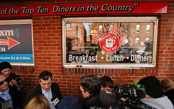Republican presidential candidate Ted Cruz talks to reporters outside the Red Arrow Diner in Manchester, N.H., in February 2016.