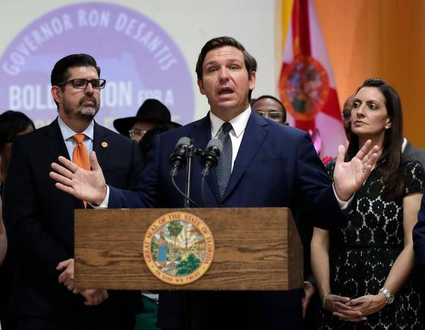 Florida Gov. Ron DeSantis, center, speaks during a bill signing ceremony on May 9 at the William J. Kirlew Junior Academy, in Miami Gardens.