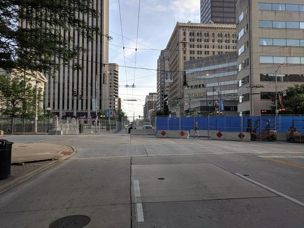 Downtown streets and businesses began closing Thursday night ahead of Saturday's rally.