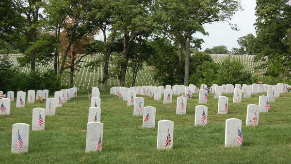 Flags mark veterans graves at Jefferson Barracks National Cemetery on a past Memorial Day.