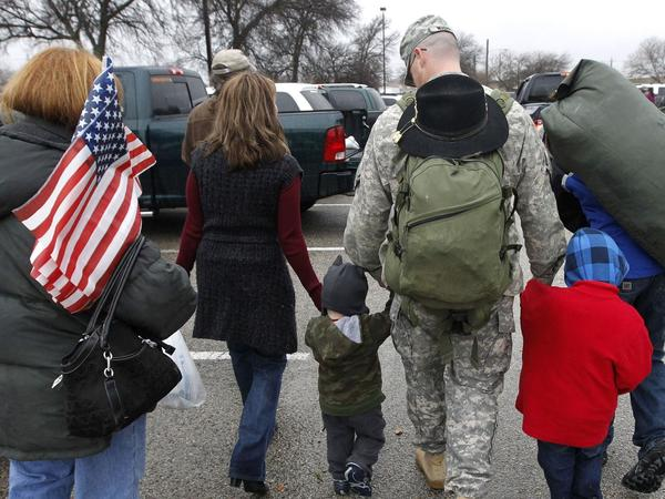 A soldier walks with his family following a 2011 ceremony at Fort Hood, Texas, for soldiers from the U.S. Army 1st Cavalry 3rd Brigade, who returned home from deployment in Iraq.
