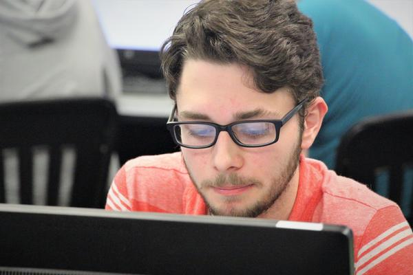 Taylor Howell works on a Java coding assignment in Lisa Whallon's class at Olathe Northwest High School.