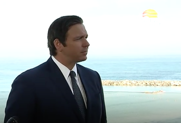 Gov. Ron DeSantis holds a press briefing Monday with a view of the Mediterranean at the Hilton Tel Aviv. He met with Israeli officials, business leaders and academics.