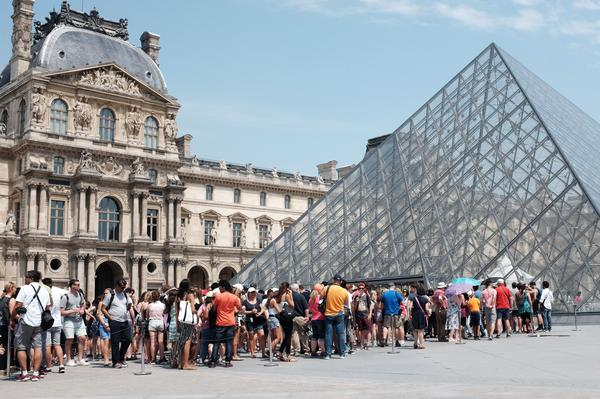 The Louvre was closed on Monday as security and reception staff went on strike over what they say are deteriorating working conditions as the museum draws record crowds. Here, visitors queue outside the Louvre in July 2015.
