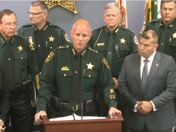 File photo of Pinellas County Sheriff Bob Gualtieri, surrounded by law enforcement officers.