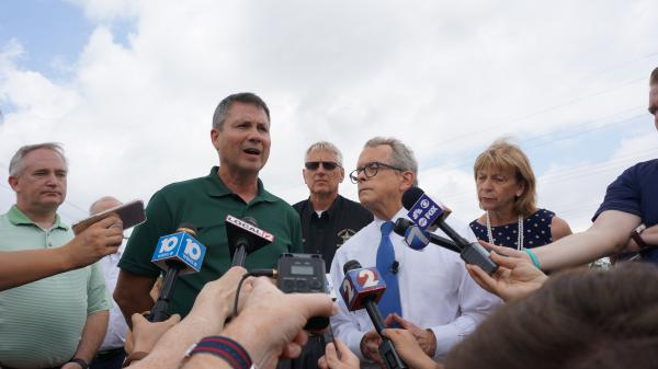 Gov. Mike DeWine discusses storm damage and clean-up operations with local leaders in Celina.