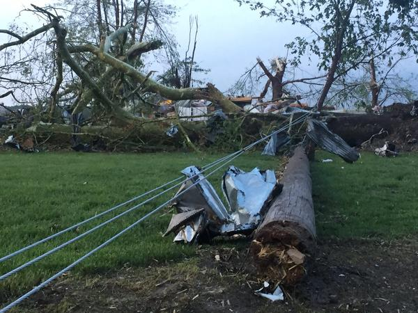 A tornado knocked down power lines and damaged buildings in Eudora, Kansas.