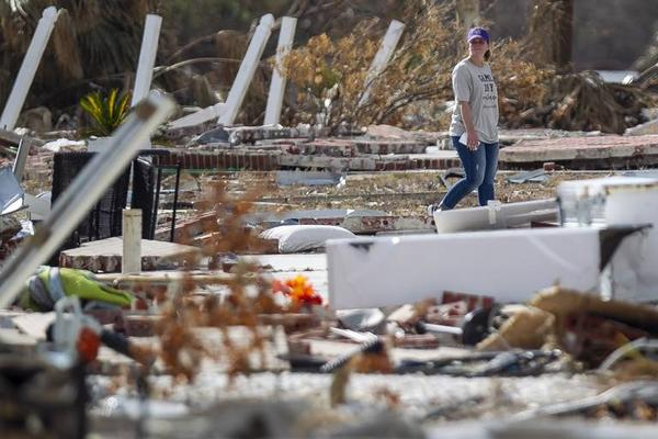 Casey Dudley, whose home was destroyed during Hurricane Michael, walks through debris in Mexico Beach in October.