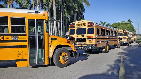School buses wait for students in South Florida.