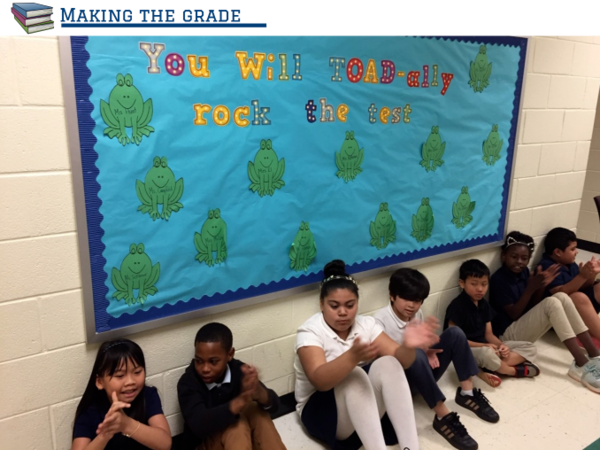 Students at Oakdale Elementary in northwest Charlotte sit below a message encouraging them to do well on their end-of-grade tests. Their performance on the tests determines how Oakdale is graded by the state. Oakdale was given a D grade in 2018.