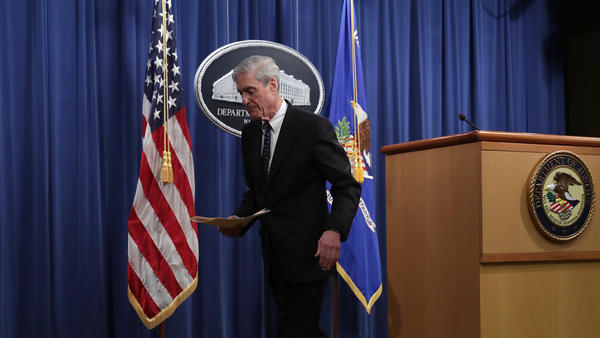 "Special counsel Robert Mueller leaves after making a statement about the Russia investigation on Wednesday at the Justice Department. After the investigation, he said, ""if we had had confidence that the president clearly did not commit a crime we would have said so."""