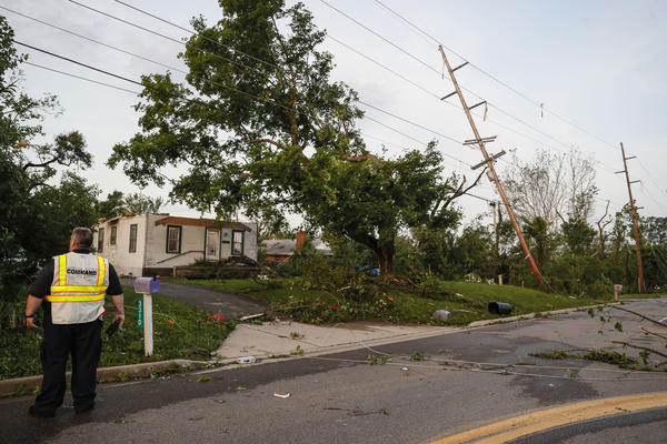 Storm damage litters a residential neighborhood Tuesday, May 28, in Vandalia, Ohio. A rapid-fire line of apparent tornadoes tore across Indiana and Ohio overnight, packed so closely together that one crossed the path carved by another.