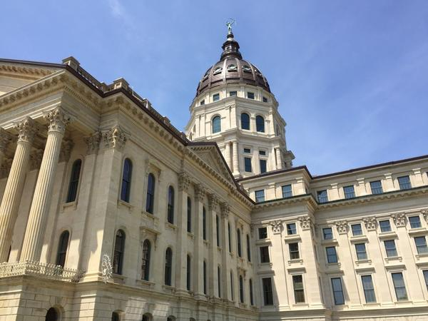 Kansas lamwakers overrode the governor's four line item vetoes in the state budget.