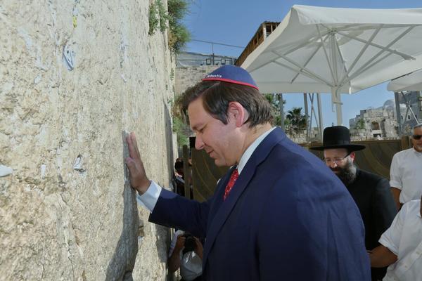 Gov. Ron DeSantis prays at Jerusalem's Western Wall Thursday.