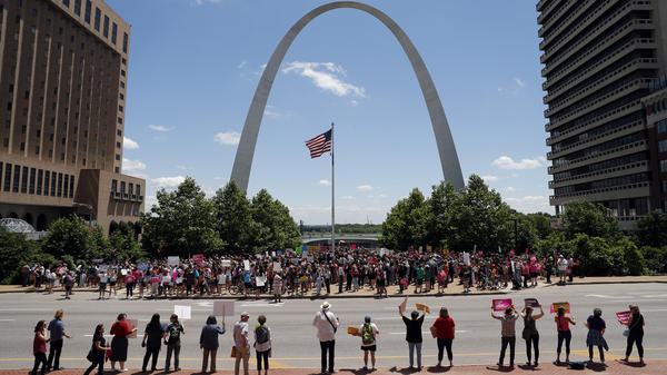 Abortion-rights supporters take part in a protest Thursday in St. Louis. A state license that allows a Planned Parenthood health center in Missouri to perform abortions could soon expire.